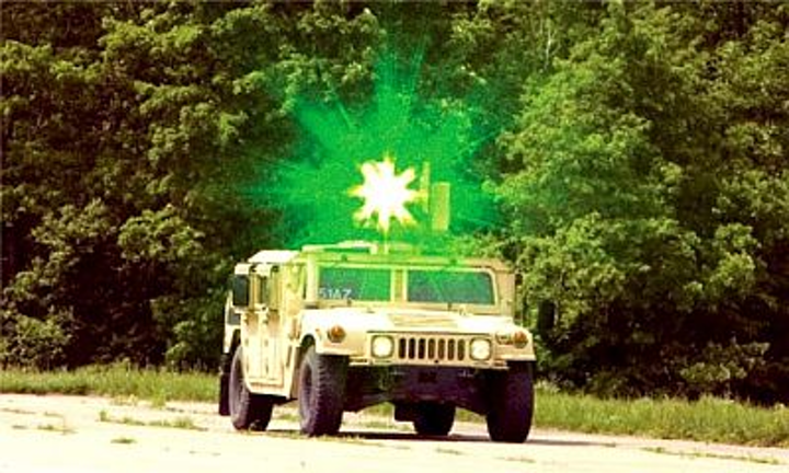 A green-emitting solid-state-laser dazzler is used from a Humvee