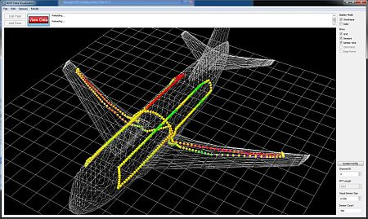 Fiber Bragg grating (FBG)-based sensor fibers can be routed within a structure as large as a commercial airplane and routed to a central interrogation unit to monitor structural integrity