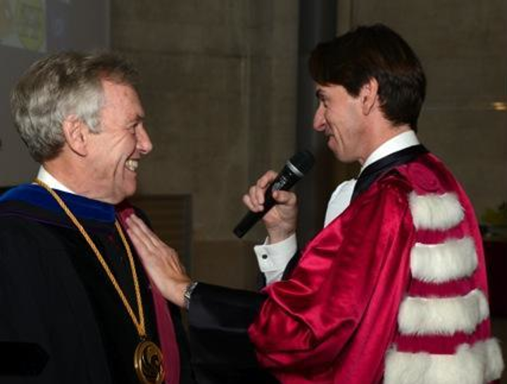 President Dean Lewis of the University of Bordeaux vests Professor Martin Richardson of the University of Central Florida with the insignia of a 'Docteur Honoris Causa' of the University of Bordeaux. (Image credit: University of Central Florida)