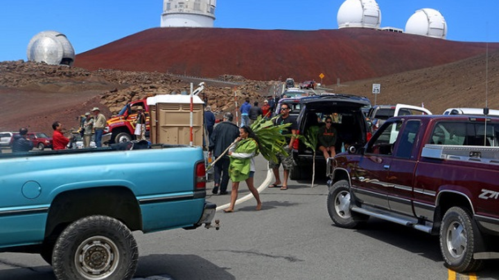 Protesters blocked vehicles headed for the Thirty Meter Telescope's groundbreaking ceremony on Mauna Kea, on the Big Island of Hawaii, in October 2014. (Image credit: Hawaii Tribune-Herald, via Associated Press)