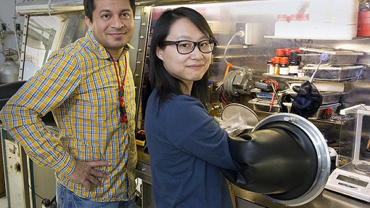 Scientists Aditya Mohite, left, and Wanyi Nie are perfecting a crystal production technique to improve perovskite crystal production for solar cells at Los Alamos National Laboratory. (Image credit: LANL)
