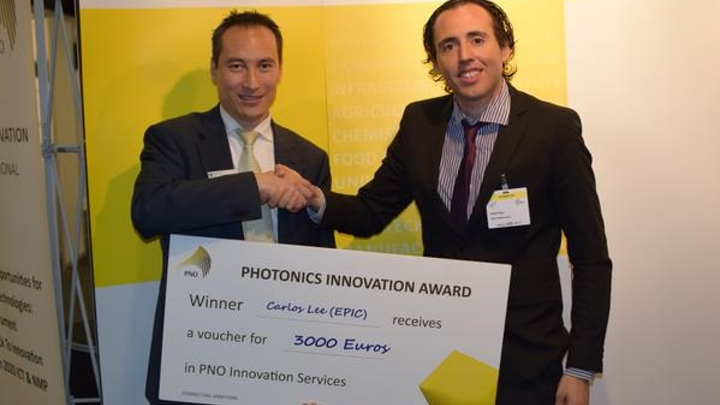 EPIC director general Carlos Lee receives the first PNO Photonics Innovation Award. (Image credit: PNO Consultants)