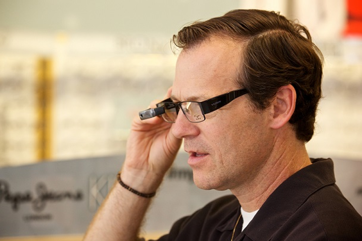 Vista, CA Chamber of Commerce CEO Bret Schanzebach tries out one of the wearable devices in Eyeglass World's new smart glass collection. (Image credit: Eyeglass World)