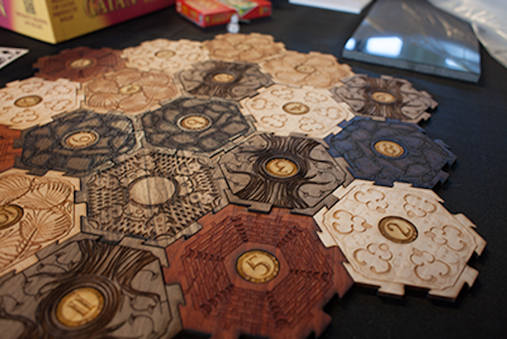 An example of Glowforge laser-printed components: in this case, laser cut and engraved board game pieces. (Image credit: Glowforge)
