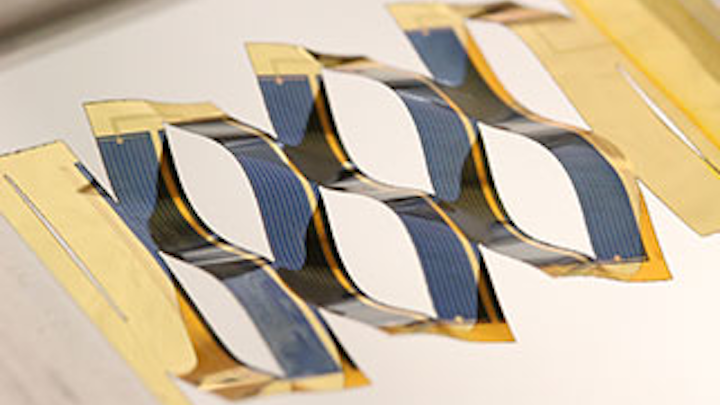 Stretched kirigami-patterned thin-film solar cells track the sun