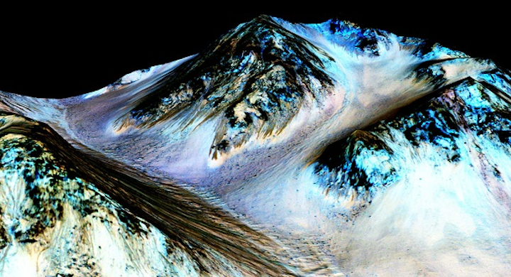 Dark, narrow streaks on Martian slopes such as these at Hale Crater are inferred to be formed by seasonal flow of water on contemporary Mars. The streaks are roughly the length of a football field. The imaging and topographical information in this processed, false-color view come from the High Resolution Imaging Science Experiment (HiRISE) camera on NASA's Mars Reconnaissance Orbiter. (Image credit: NASA)