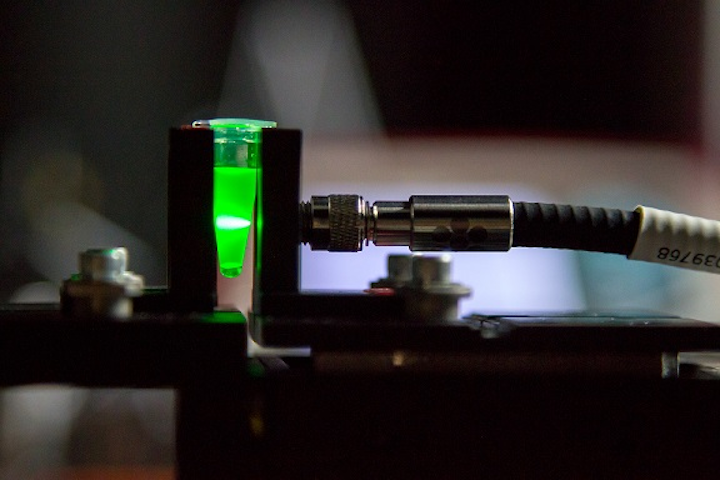 A laser shines through a blood sample to make vitamin B12 molecules vibrate, facilitating a light-based measurement that can diagnose dementia. (Image credit: University of Adelaide)