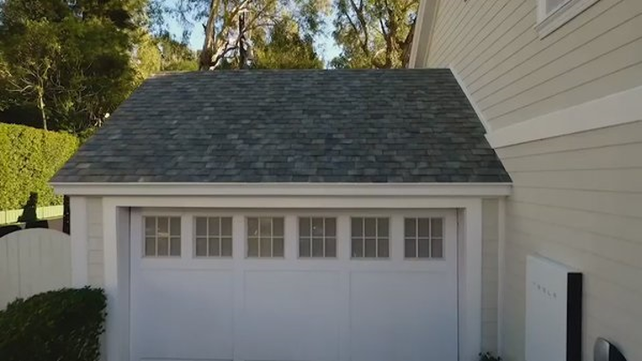 Elon Musk of Tesla launches stylish solar roof tiles that generate electricity to be stored in a battery for future use. (Image credit: Bloomberg)