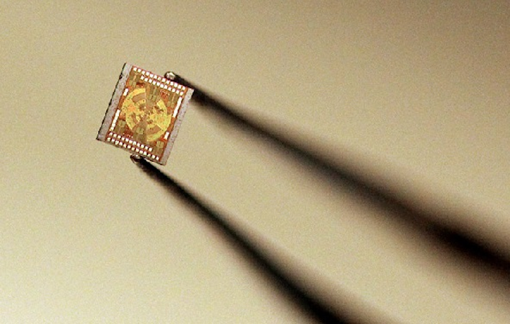 Princeton University researchers have drastically shrunk the equipment for producing terahertz radiation from a tabletop setup to a pair of microchips. This simpler, cheaper generation of terahertz has potential for advances in medical imaging, communications, and drug development. (Image credit: Frank Wojciechowski for the Office of Engineering of Princeton University)