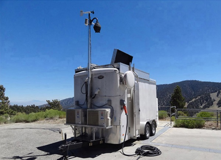 A photograph shows the Autonomous Mobile Ozone Lidar Instrument for Tropospheric Experiments (AMOLITE) mounted in a climate-controlled mobile trailer. (Image credit: SPIE Newsroom)