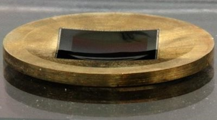 Spherically curved CMOS array improves image quality across the field