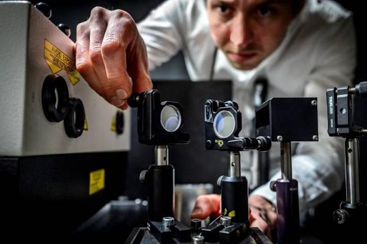 Elias Kristensson of Lund University works on the ultrafast five trillion frame-per-second camera. (Image credit: Kennet Ruona/Lund University)