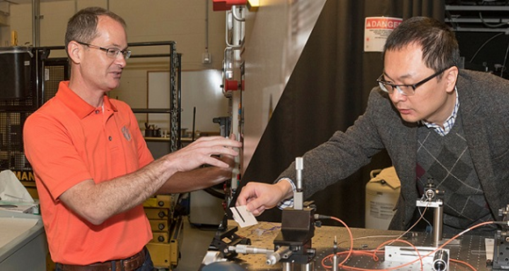 John Ballato (left) and Lin Zhu are receiving a combined $3.2 million from the Department of Defense to develop high-energy lasers. (Image credit: Clemson University)