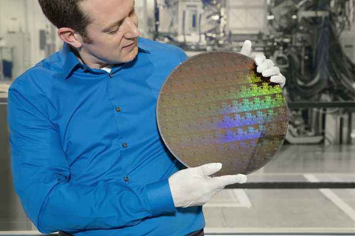 IBM Research scientist Nicolas Loubet holds a wafer of chips with 5nm silicon nanosheet transistors manufactured using an industry-first process that can deliver 40 percent performance enhancement at fixed power, or 75% power savings at matched performance. (Image credit: IBM/Connie Zhou)