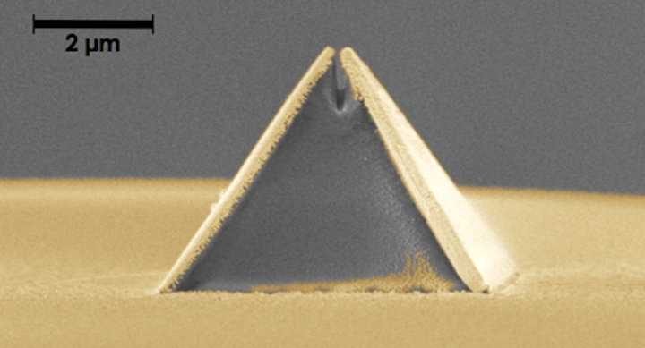 A new process called fiber nanoimprinting speeds fabrication of nanooptical devices, such as this pyramid-shaped Campanile probe imprinted on an optical fiber (captured in a scanning electron microscope image). The gold layer is added after imprinting and the gap at the top is 70 nm wide. (Image credit: Berkeley Lab)