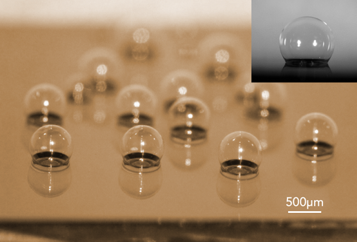 A chip-scale glass microspherical shell sensor array is shown blown on a silicon substrate. Insert is a near-perfect spherical shell. (Image credit: Tadigadapa Lab/Penn State)