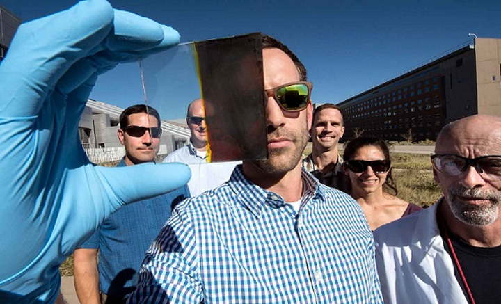 Lance Wheeler (front) developed a switchable photovoltaic window along with (from left) Nathan Neale, Robert Tenent, Jeffrey Blackburn, Elisa Miller, and David Moore. (Image credit: Dennis Schroeder/NREL)