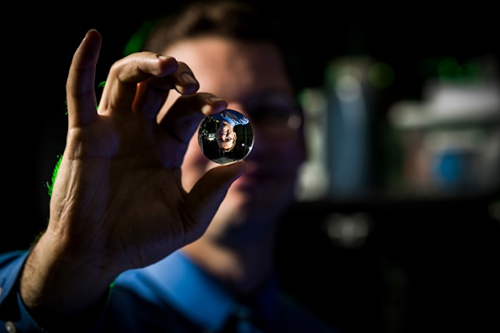 A BYU researcher 'holds' a volumetric display image that seems to float in thin air. (Image credit: Brigham Young University)
