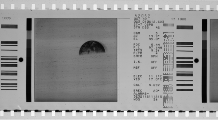 A typical film image from a Surveyor mission with a CRT display (left) and associated data fields (right) is shown; this is the data that the University of Arizona is tasked with digitizing and storing. (Image credit: Matrox Imaging)