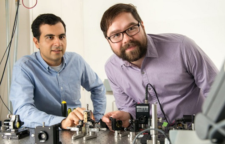 Alireza Marandi, left, and Marc Jankowski prepare to carry out experiments at the optical bench that generate better ultrashort pulses. (Image credit: L.A. Cicero/Stanford University)