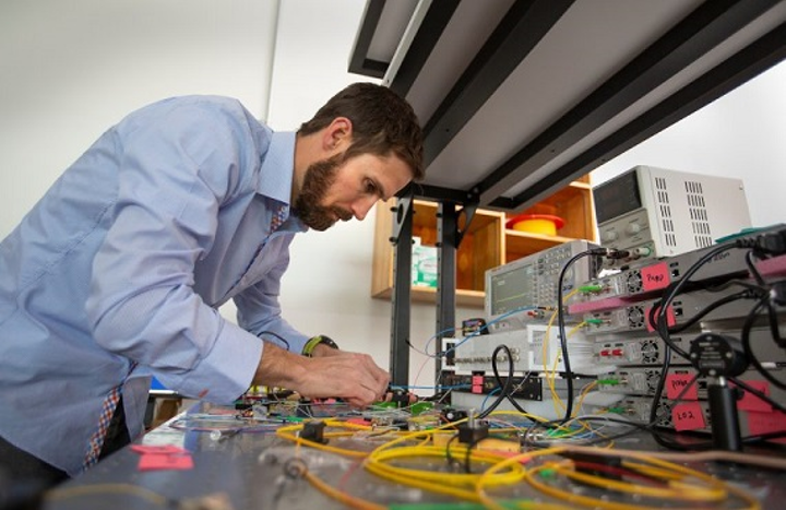 NAU physicist Ryan Behunin's research explores the physics of fluctuation-induced phenomena and optomechanics, investigating fundamental questions regarding the interaction of light, sound and matter--from quantum friction to laser noise. (Image credit: Northern Arizona University)