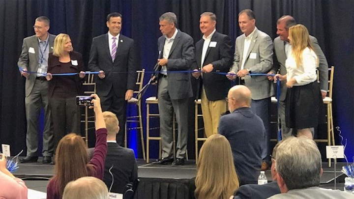 Finisar CEO Michael Hurlston cuts the ribbon at the company's new Sherman manufacturing plant on July 9, 2018. (Image credit: KTEN)