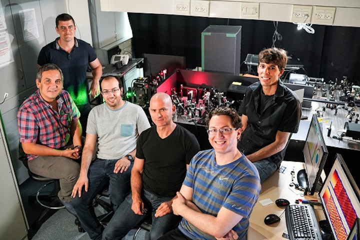 Research participants in the Bartal lab at the Faculty of Electrical Engineering at Technion are shown (right to left): professor Netanel Lindner, Shai Tsesses, professor Guy Bartal, Kobi Cohen, Evgeni Ostrovsky, and Bergin Gjonaj. (Image credit: ATS)