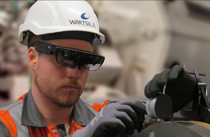 A service engineer at Wärtsilä is using smart glasses when carrying out maintenance work. (Image credit: Wärtsilä)