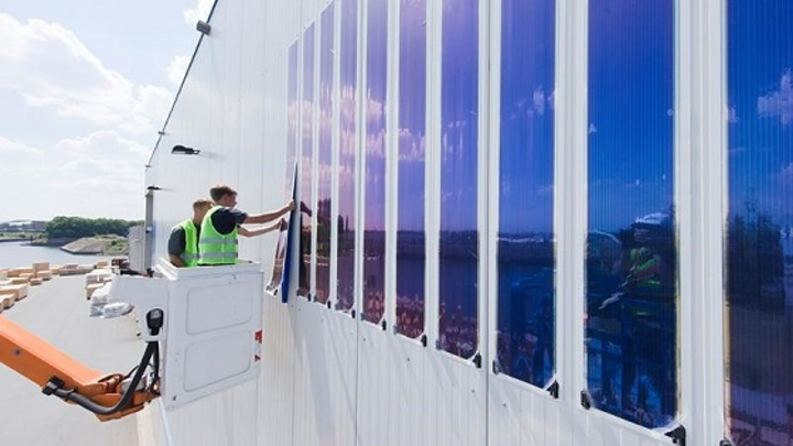 Installation of the organic photovoltaic (OPV) façade in the port of Duisburg was rapid and easy, and will generate energy for years to come. (Image credit: innogy/Heliatek)