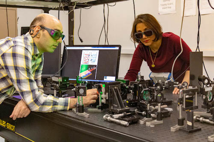 Supersymmetric coherent laser beam combination produces high-quality beam