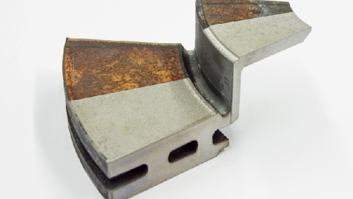 "Shown is a rusty component ""cleaned"" with laser technology. (Image credit: TLM Laser)"