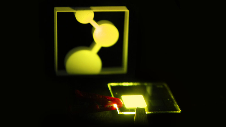 The first prototype of a new single-layer OLED developed in Mainz, Germany illuminates the logo for its developer, the Max Planck Institute for Polymer Research, MPI-P.