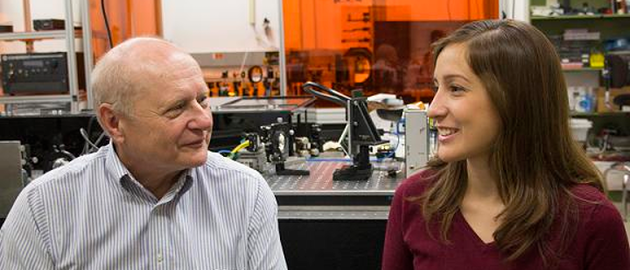 James C. Wyant with Maria Ruiz in 2014, a first-year graduate student at the College of Optical Sciences, who that year received a Louise Wyant Memorial Scholarship in Optical Sciences. James Wyant and his family are now contributing $2 million and SPIE $500,000 to an educational-funding initiative for optics and photonics.