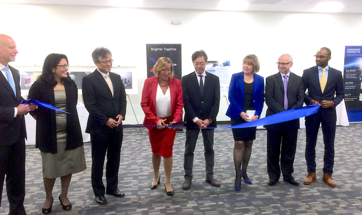 As representatives of Energetiq Technology and Hamamatsu (which acquired Energetiq in 2017) look on, Debbie Gustafson, CEO of Energetiq, cuts the ribbon in the grand opening ceremony for the company's new facility in Wilmington, MA.